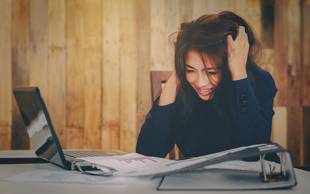 Business woman stressed busy girl working