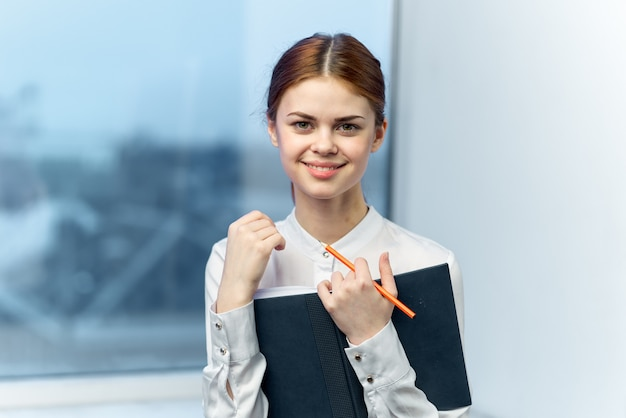 Business woman student in glasses on window