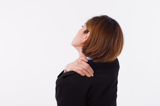Business woman suffering from shoulder pain