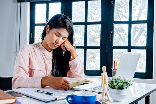 Business woman suffering stress working at office asking for help feeling tired.