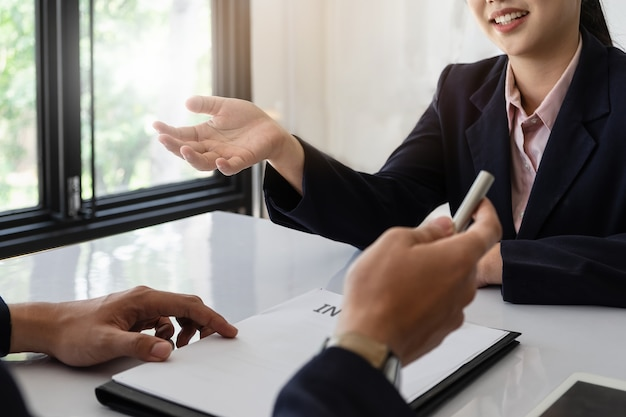 Business woman in suit is smiling and answer of question