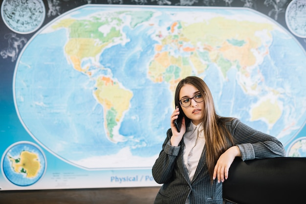 Business woman talking by phone in office