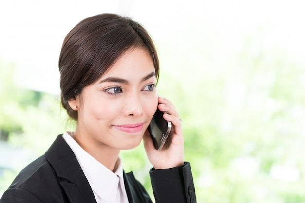 Business woman talking cellphone