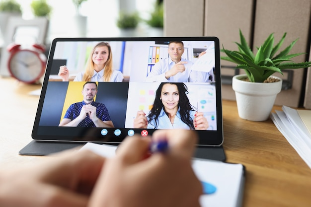 Business woman talking to colleagues about plan in video conference business team using laptop