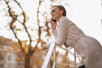 Business woman talking on the phone outside