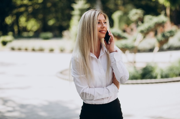 Business woman talking on the phone in park