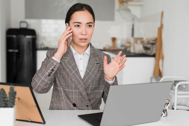 Business woman talking over phone