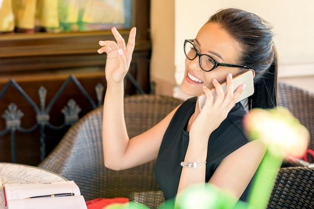 Business woman talks on phone.