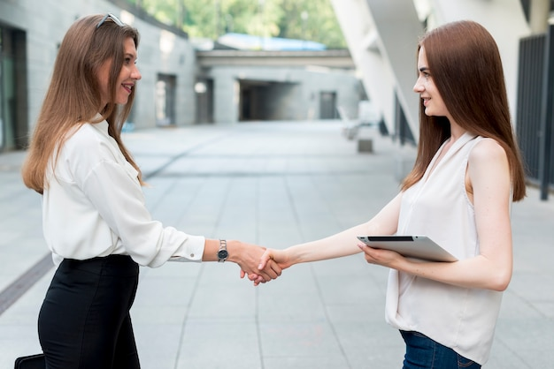 Business woman together at the street