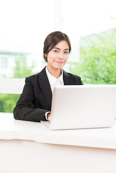 Business woman using computer laptop