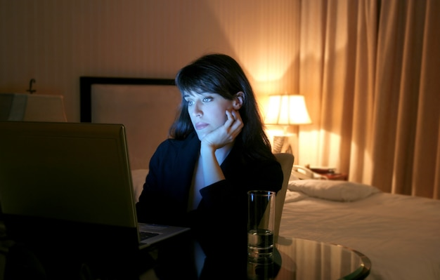 Business woman  using laptop in a hotel room