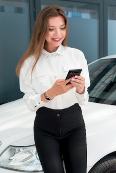 Business woman using smartphone in the street