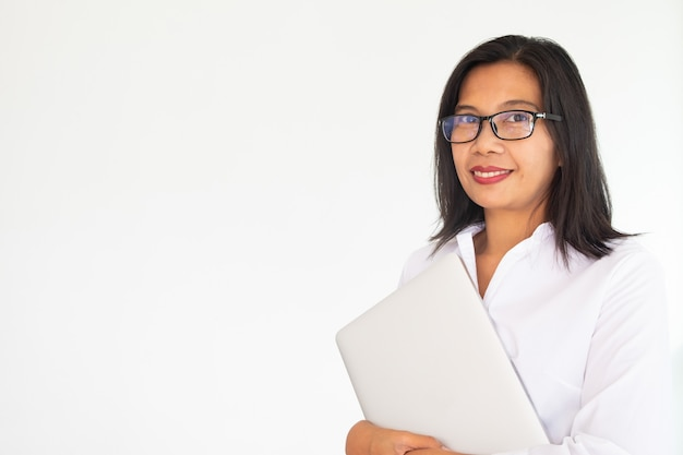 Business woman wearing glasses holding labtop notebook on white background