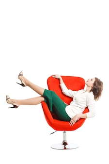Business woman in a white blouse and green skirt resting