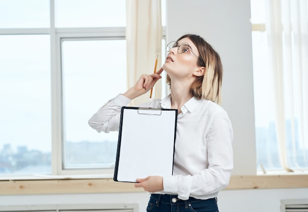 Business woman in white shirt documents office