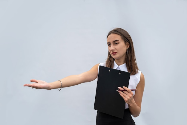 Business woman in white shirt holding document on clipboard, isolated on a white background.