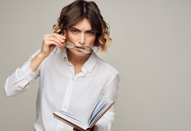 Business woman in a white shirt with a book in the hands of professionals working. high quality photo