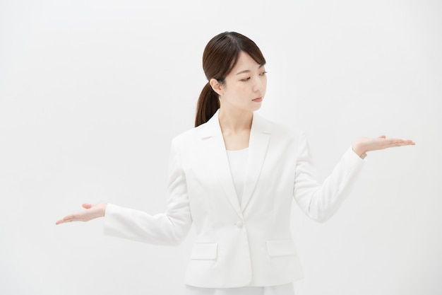 A business woman who poses like comparing two options