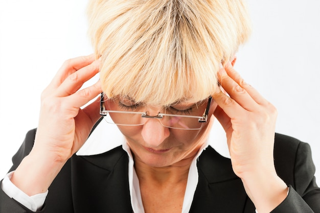 Business woman with headache or burnout