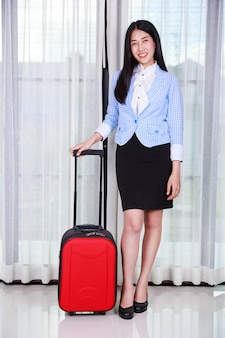 Business woman with luggage or suitcase
