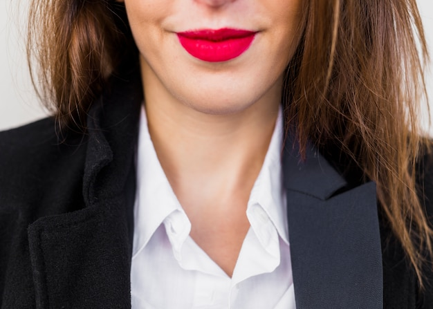 Business woman with red lips in black suit