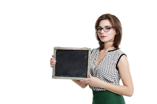 Business woman with short hair wearing glasses holding a card. wearing glasses with empty blackboard. beautiful woman in a light blouse and green  skirt