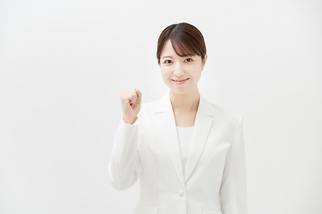 Business woman with white suits take a cheering pose