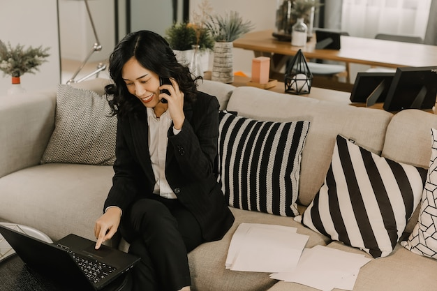 Business woman working and calling cell phone.