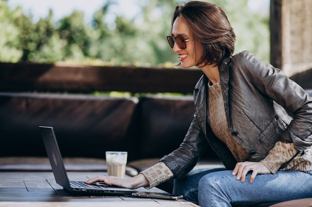 Business woman working on laptop out of home