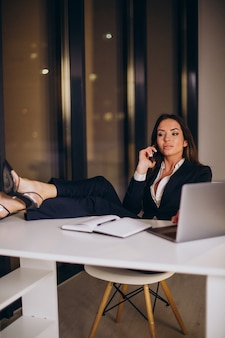 Business woman working late at night at the office