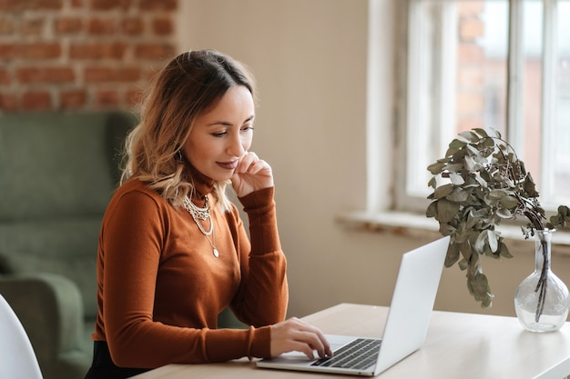 A business woman working online from home