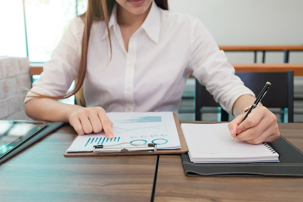 Business woman at working with financial reports.