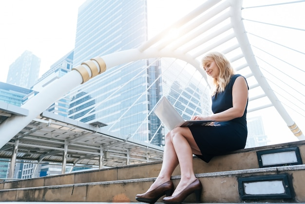 Business woman working with laptop at outdoors
