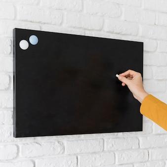 Business woman writing on chalkboard