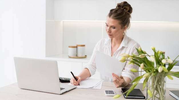 Business woman writing document