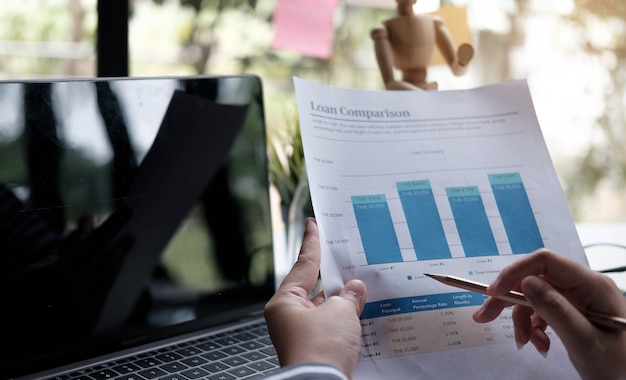 Business women reviewing data in financial charts and graphs