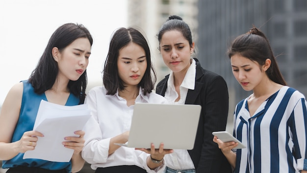 Business women team with serious tired depressed unemployed outdoor