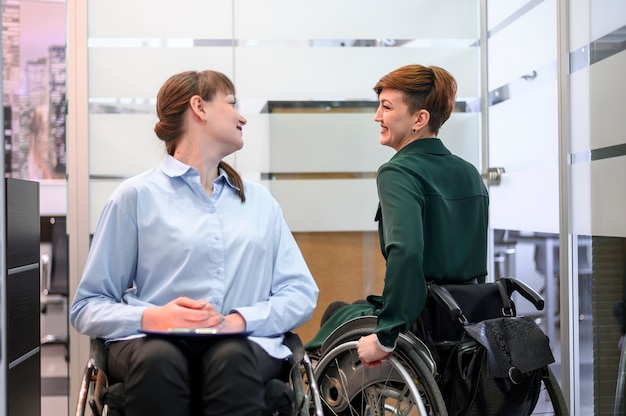 Business women in wheelchairs meeting