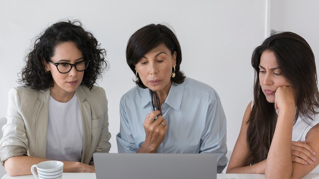 Business women working on difficult project