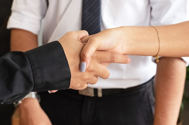 Business worker shaking hands together,sign and symbol of success deal and trust,