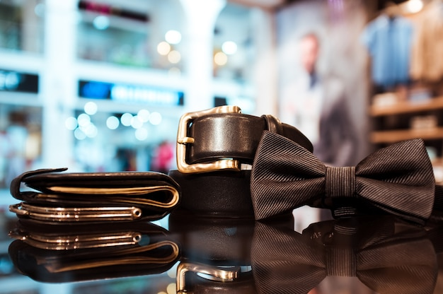 Businessman accessories. bow tie belt and purse in shop