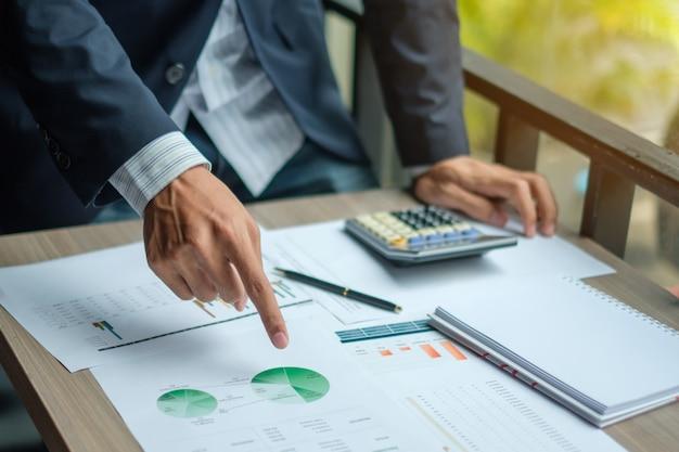 Businessman analysis maketing plan,
