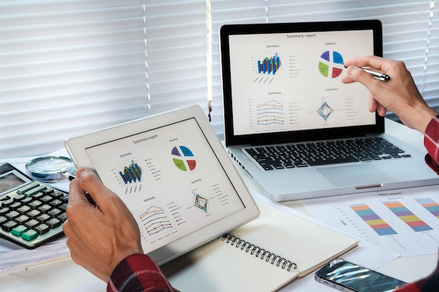 Businessman analyzing financial figures denoting the progress in the work of the company
