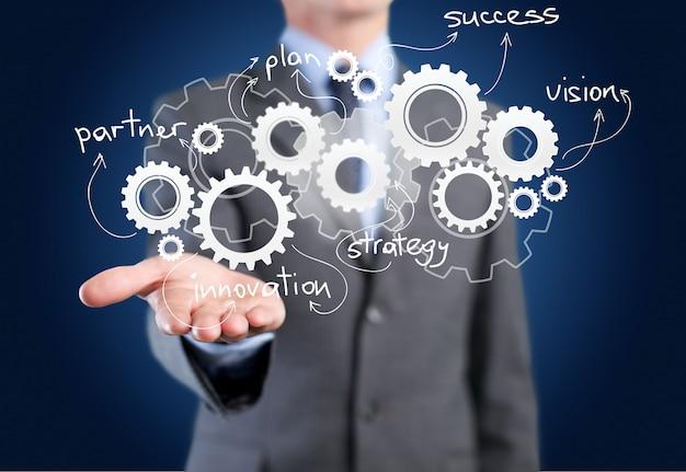 Бизнесмен и деловые символы на фоне