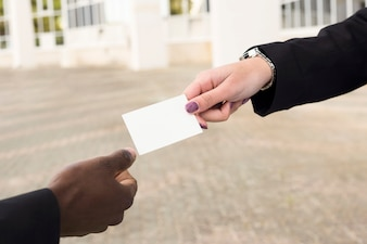 Businessman and businesswoman exchanging business card