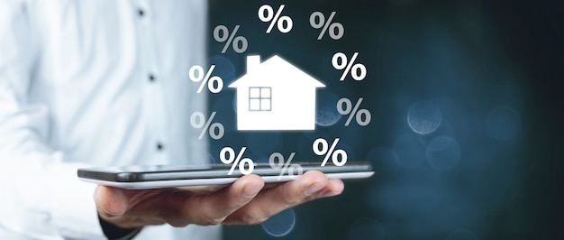 ビジネスマンと家のパーセントアイコン