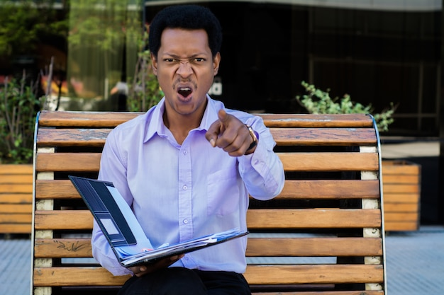 Businessman angry shouting someone.