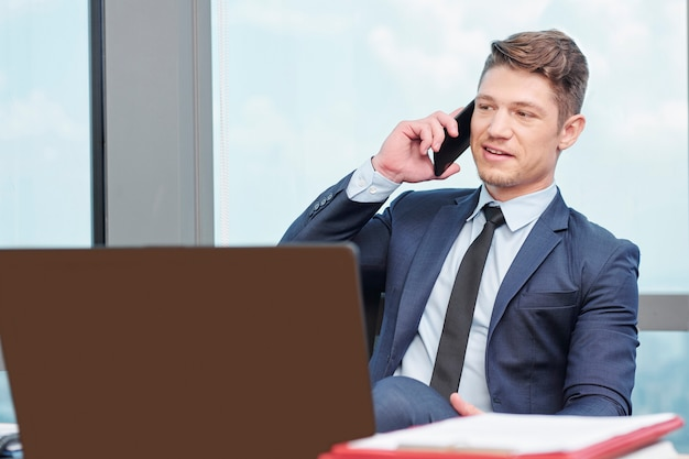 Businessman answering phone