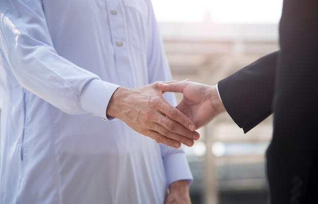 Businessman arabic with engineer making handshake agreement