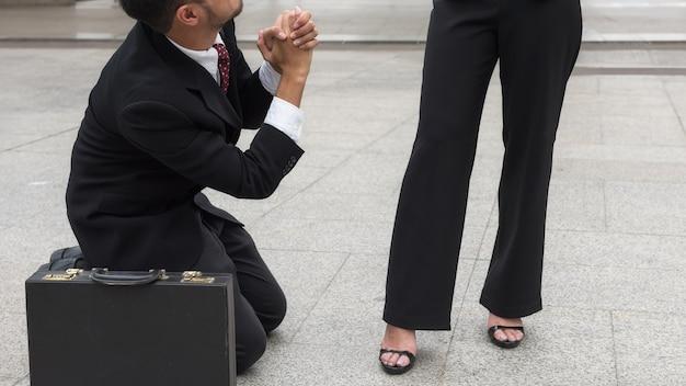 Businessman ask female boss for sympathy